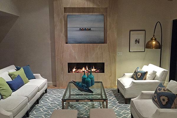 02_3447 Padaro Lane living room fireplace at night
