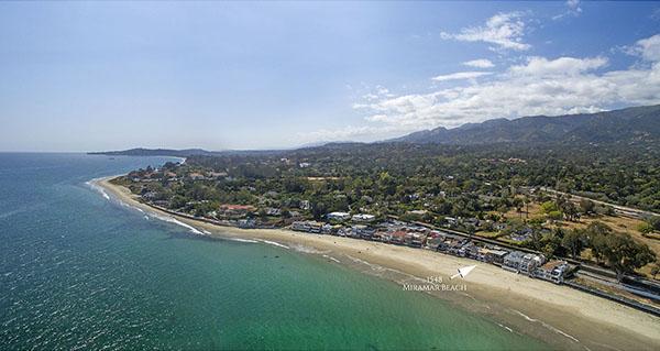 24_1548 Miramar Beach aerial up coast higher
